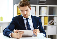 Businessman using his tablet Stock Images