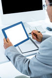 Businessman using his tablet Royalty Free Stock Photo