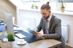 Businessman using his tablet in the office royalty free stock photos