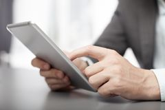 Businessman using his tablet in the office stock photos