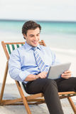 Businessman using his tablet pc Royalty Free Stock Photo