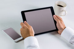 Businessman using his tablet pc Stock Image