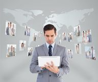 Businessman using his tablet pc Royalty Free Stock Images