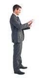 Businessman using his tablet pc Royalty Free Stock Photography