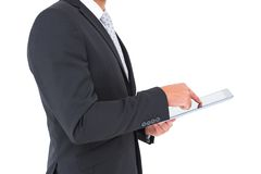 Businessman using his tablet pc Royalty Free Stock Photos