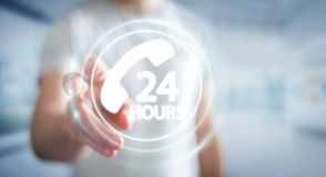 Businessman using hotline customer assistance 3D rendering. Businessman on blurred background using hotline customer assistance 3D rendering Stock Photo