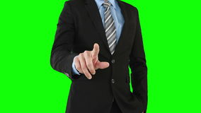Businessman using an invisible touchscreen