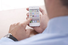 Businessman using Iphone. On the Desk Stock Photos