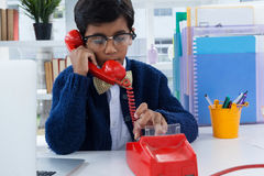 Businessman using land line phone. At desk in office Royalty Free Stock Images