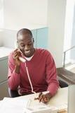 Businessman Using Landline At Desk Royalty Free Stock Photography