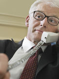 Businessman Using Landline Phone Stock Images