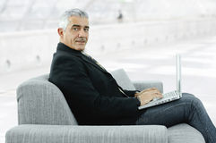 Businessman using laptop Stock Images