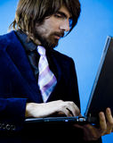 Businessman using a laptop royalty free stock images
