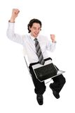 Businessman using laptop. Young businessman sitting with laptop Royalty Free Stock Photography