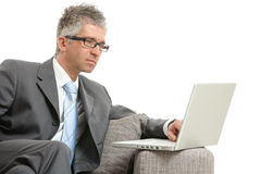 Businessman using laptop Stock Photography