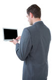 Businessman using a laptop. Against white background Stock Photography