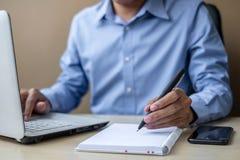 Businessman using laptop analysis marketing plan. Business, Finance concepts stock photo