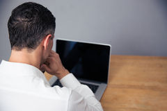 Businessman using laptop with blank screen Stock Image