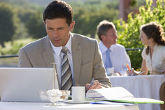 Businessman using laptop at caf? Royalty Free Stock Photo