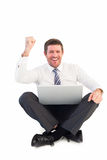 Businessman using laptop and cheering Stock Image