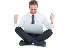 Businessman using laptop and cheering Royalty Free Stock Image