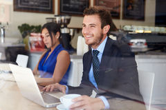 Businessman Using Laptop In Coffee Shop Stock Photography
