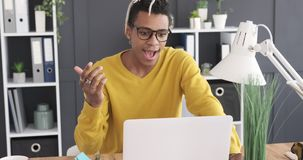 Businessman using laptop and coming up with a brilliant idea. Thoughtful african american businesswoman working on laptop and coming up with a brilliant idea stock footage