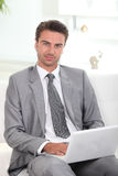 Businessman using a laptop computer Royalty Free Stock Photo