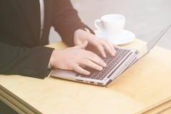 Businessman using laptop computer Stock Image