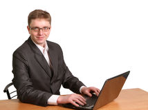 Businessman using laptop computer Isolated Stock Photo