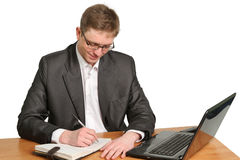 Businessman using laptop computer smiling Isolated on white Royalty Free Stock Photos