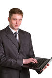 Businessman using laptop computer Royalty Free Stock Photography