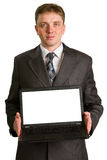 Businessman using laptop computer Stock Images
