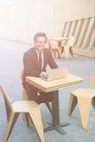 Businessman using laptop computer Stock Photos