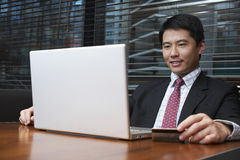 Businessman Using Laptop And Credit Card At Restaurant Table Royalty Free Stock Photography