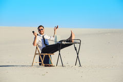 Businessman using  laptop in a desert Royalty Free Stock Image
