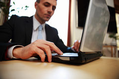 Businessman using laptop. Focus on laptop Royalty Free Stock Images