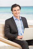 Businessman using laptop on the hammock Royalty Free Stock Images