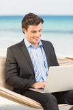 Businessman using laptop on the hammock Royalty Free Stock Photos