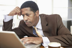 Businessman Using Laptop With Hand On Head Stock Photos