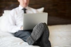 Businessman using laptop in hotel. Close-up royalty free stock photography