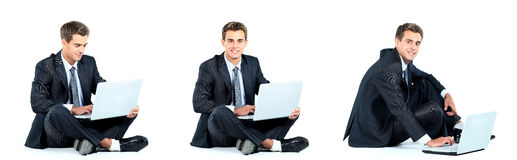 Businessman using a laptop. Isolated seated young businessman using a laptop Royalty Free Stock Images
