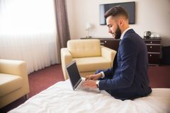 Businessman Using Laptop in Luxury Hotel Stock Images