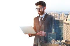 Businessman using laptop multiexposure Stock Image