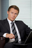 Businessman using laptop in office Stock Photos