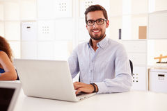 Businessman Using Laptop In Office Of Start Up Business Royalty Free Stock Image