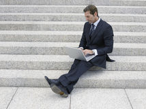 Businessman Using Laptop Of Office Steps Stock Photos
