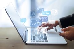 Businessman using laptop for online payment stock photo