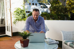 Businessman using laptop in outdoor cafe Royalty Free Stock Photography