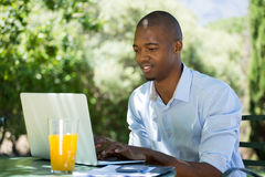 Businessman using laptop at restaurant Royalty Free Stock Photography